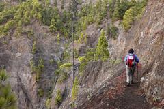 Stock Photo of Spain, Mature woman hiking in Caldera de Taburiente National Park