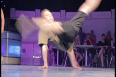 Break dancer spinning dancing head on floor, male performance, click for HD - stock footage