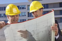 Germany, Bavaria, Munich, Engineers with blue print - stock photo