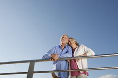 Spain, Mallorca, Senior couple looking away, smiling - stock photo
