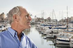 Spain, Mallorca, Palma, Senior man standing at harbour - stock photo