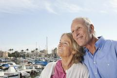 Stock Photo of Spain, Mallorca, Palma, Senior couple at harbour, smiling