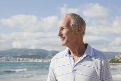 Spain, Mallorca, Senior man standing at sea shore - stock photo