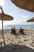 Spain, Mallorca, Senior couple on deck chair at beach Stock Photos