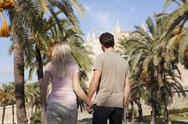 Stock Photo of Spain, Mallorca, Palma, Couple walking along allee