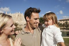 Spain, Mallorca, Palma, Family standing together, smiling Stock Photos