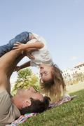 Spain, Mallorca, Palma, Father and daughter playing, smiling - stock photo