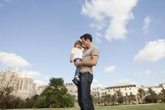 Stock Photo of Spain, Mallorca, Palma, Father carrying daughter, smiling