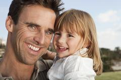 Stock Photo of Spain, Mallorca, Palma, Father and daughter smiling, close up