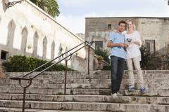 Spain, Mallorca, Palma, Couple with guidebook, portrait - stock photo