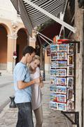 Spain, Mallorca, Palma, Couple looking at postcards - stock photo