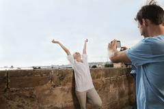Spain, Mallorca, Palma, Couple photographing with mobile phone - stock photo