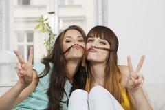 Germany, Berlin, Young women having fun, smiling Stock Photos