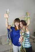 Stock Photo of Germany, Berlin, Young women having fun, smiling