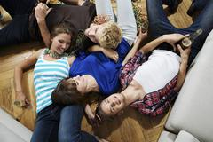 Germany, Berlin, Group of young people having fun Stock Photos