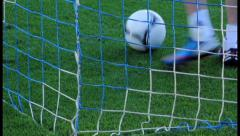 Football ball being taken out of the net after goal., click for HD Stock Footage