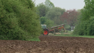 Tractor turns at edge of field and starts plowing Stock Footage