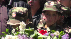 Genocide monument, kids in army uniform, Yerevan Stock Footage