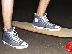 Germany, Duesseldorf, Human foot on skateboard, close up Stock Photos