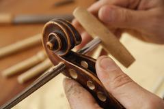 Germany, Upper Bavaria, Schaeftlarn, Violin maker making violin, close up - stock photo