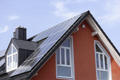 Europe, Germany, Bavaria, Munich, Solar panels on roof Stock Photos