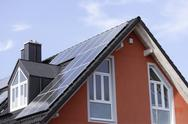 Stock Photo of Europe, Germany, Bavaria, Munich, Solar panels on roof