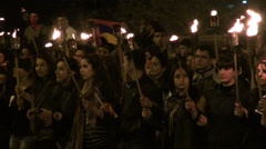Genocide Memorial Day, young people carrying torches and candles Stock Footage