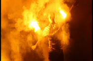 Stock Video Footage of Smokes and fires, man spinning burning chain fire pois night, click for HD