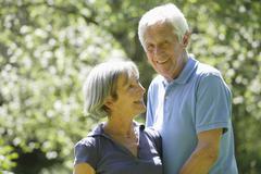 Germany, Bavaria, Senior couple smiling - stock photo