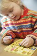 Germany, Bavaria, Girl learning spelling Stock Photos