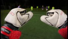 Goalkeeper POV. Saving a goal in a soccer (football) game, click for HD Stock Footage