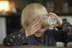 Stock Photo of Germany, Bavaria, Girl drinking from glass