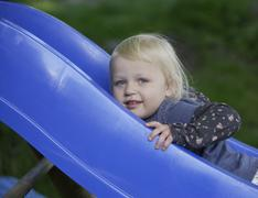 Germany, Bavaria, Girl playing on slide Stock Photos