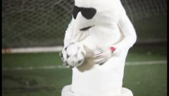 Funny man in condom costume acting as a football goalkeeper, click for HD Stock Footage