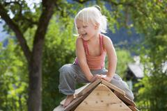 Stock Photo of Germany, Girl playing on playground