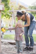Germany, Mother with daughter on playground Stock Photos