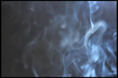 Smoke & Fume (Reek) on a gray background. Fire not in shot., click for HD - stock footage