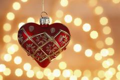 Heart shaped christmas tree ball with chain of lights - stock photo
