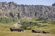 Stock Photo of Italy, View of Seiser Alm, alpine meadow and alpine huts, Roterdspitz in