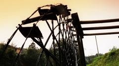 Low angle view of Chinese ancient waterwheel in sunlight. - stock footage