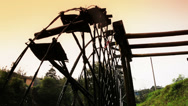 Stock Video Footage of Low angle view of Chinese ancient waterwheel in sunlight.
