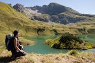 Stock Photo of Germany, Bavaria, Mid adult woman looking at Schrecksee Lake