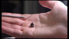Su Jok Therapy acupuncture moxa dropped out from hand to ashtray, click for HD Stock Footage