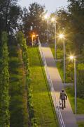 Germany, Baden Wuerttemberg, Stuttgart, Teenage boy walking up stairs with Stock Photos