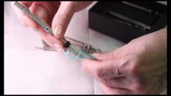 Acupuncture: demonstration of Su Jok needles and inserter., click for HD Stock Footage