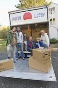 Germany, Bavaria, Grobenzell, Family with cardboard box in truck for moving Stock Photos