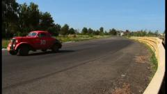 Vintage red car Chevrolet Fangio Coupe driving at high speed., click for HD Stock Footage