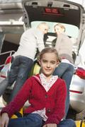 Germany, Leipzig, Family loading luggage into car, smiling Stock Photos
