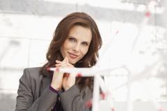 Germany, Leipzig, Businesswoman with wind power model - stock photo