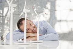 Germany, Leipzig, Businessman with wind power model - stock photo